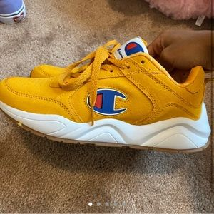 Yellow red and blue champion shoes